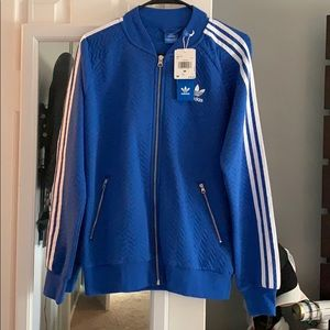 Adidas Women's Blue quilted track jacket.